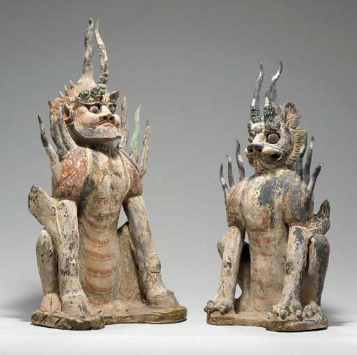 A PAIR OF PAINTED GREY POTTERY FIGURES OF EARTH SPIRITS