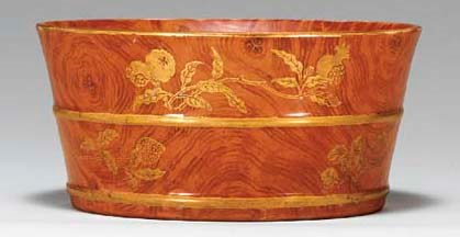 A SMALL GILT-DECORATED FAUX BO