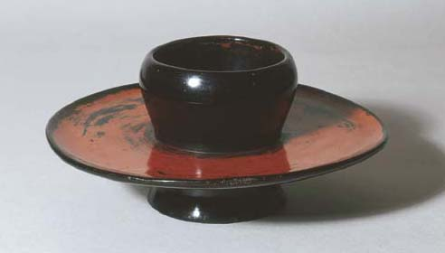 A Black and Red Negoro Stand f