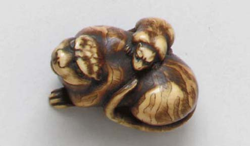 An Ivory and a Lacquered-Wood Netsuke**