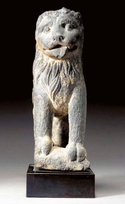 A Gray Schist Lion Form Throne