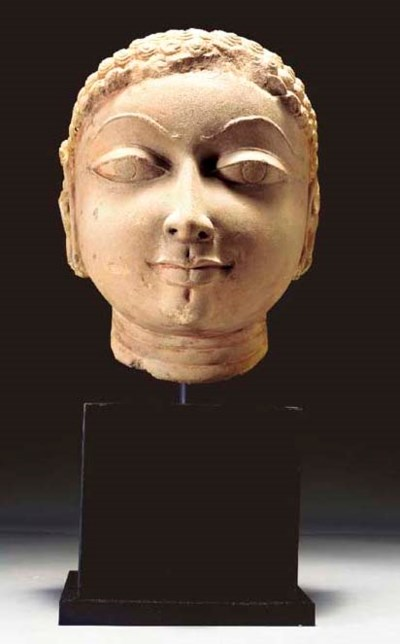 A Buff Sandstone Head of a Jin