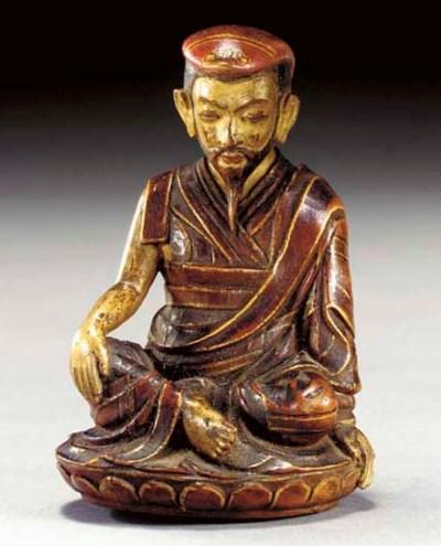A Small Polychromed Wood Figur