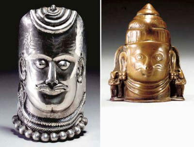 A Rare Silver Repoussé Mask of