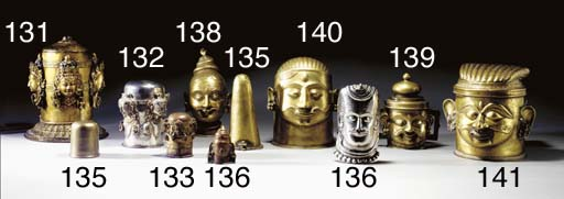 A Brass Linga in Head-Form wit