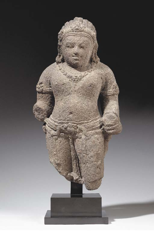 A Volcanic Stone Figure of a Guardian