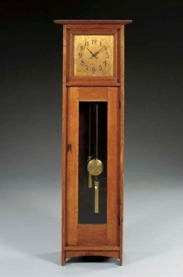 AN OAK TALL CASE CLOCK