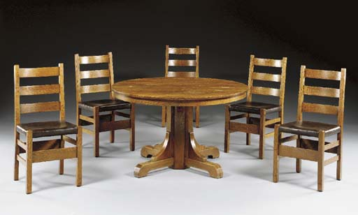 AN OAK DINING TABLE AND FIVE DINING CHAIRS