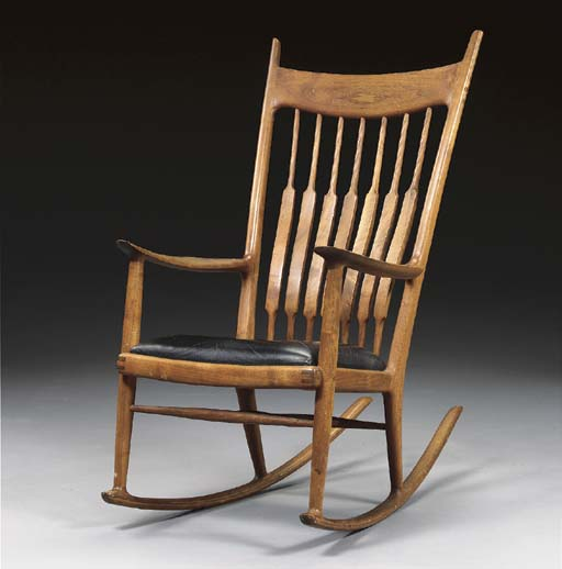 A WALNUT ROCKING CHAIR