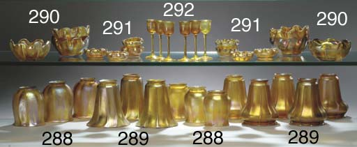 A GROUP OF GOLD FAVRILE GLASS SHADES