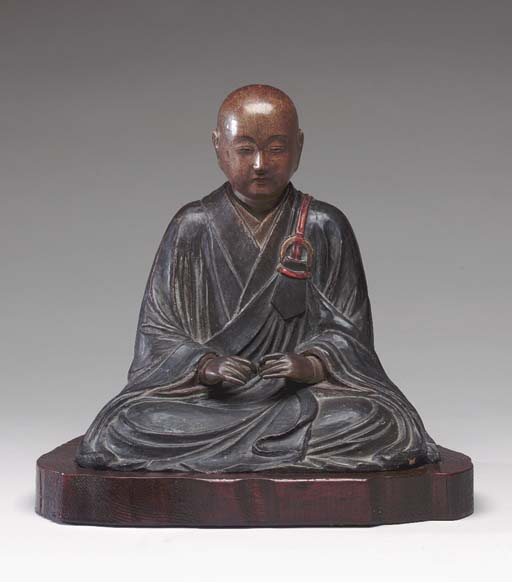 A LACQUERED WOOD FIGURE OF A S