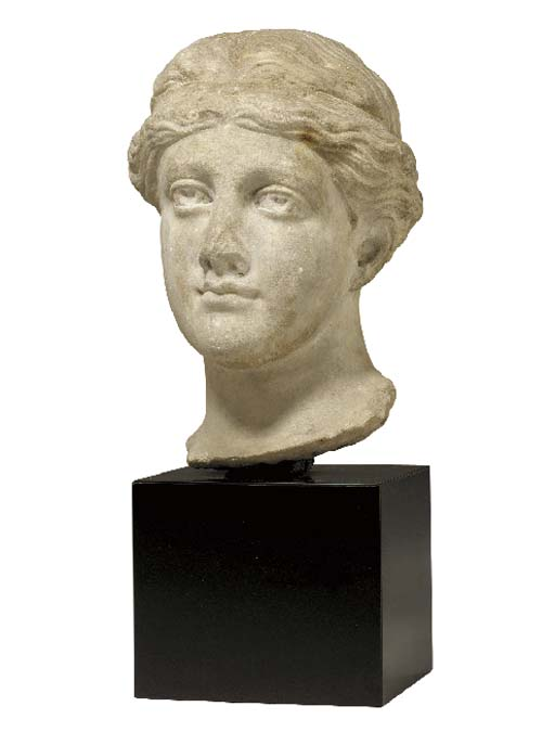 A ROMAN STYLE MARBLE HEAD OF A