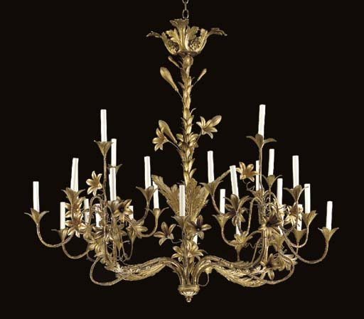 A CONTINENTAL ROCOCO STYLE GOLD PAINTED METAL 24-LIGHT CHANDELIER,