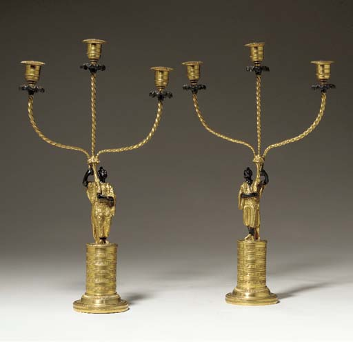A PAIR OF LOUIS-PHILIPPE BLACK-PAINTED, PATINATED-BRONZE AND ORMOLU THREE-LIGHT CANDELABRA,