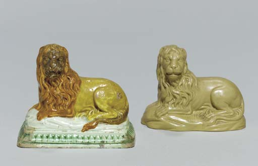 TWO STAFFORDSHIRE MODELS OF RECUMBENT LIONS,