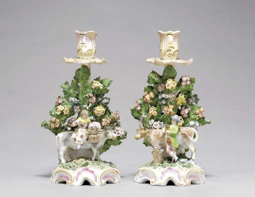 A PAIR OF BOW STYLE CANDLESTIC