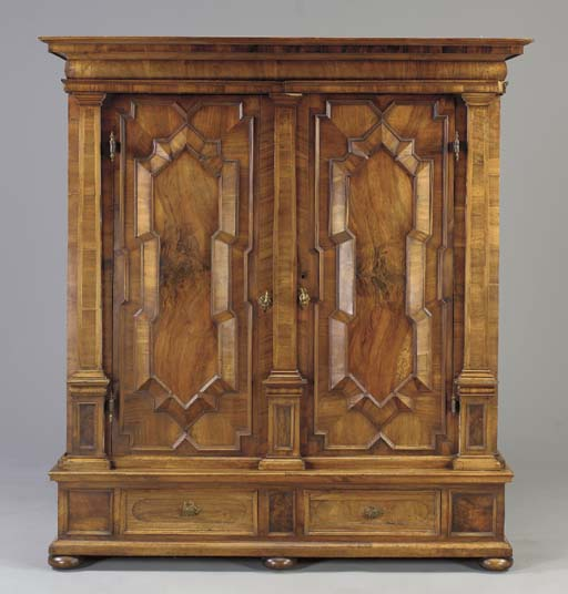 A GERMAN BAROQUE WALNUT KAS,