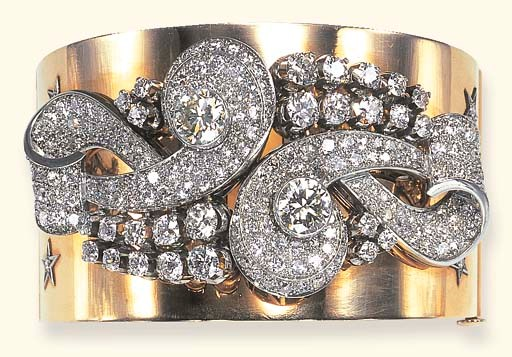 A DIAMOND AND GOLD BANGLE BRAC