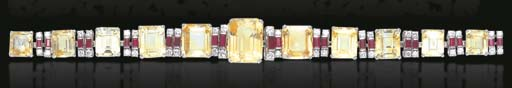A YELLOW SAPPHIRE, RUBY AND DI