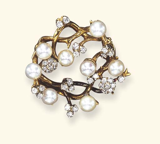 A CULTURED PEARL AND DIAMOND F