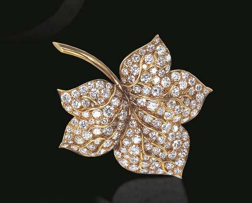 A DIAMOND FOLIATE BROOCH, BY V