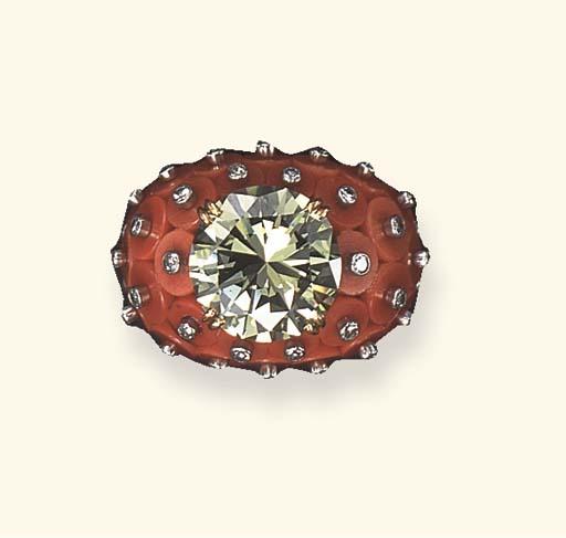 A TREATED COLORED DIAMOND, DIA