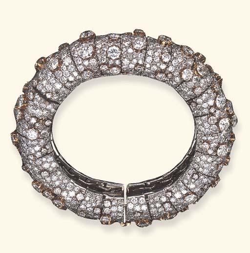 A DIAMOND BANGLE BRACELET, BY