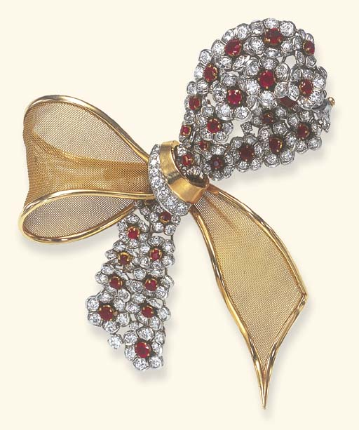 A RUBY, DIAMOND AND GOLD BOW B