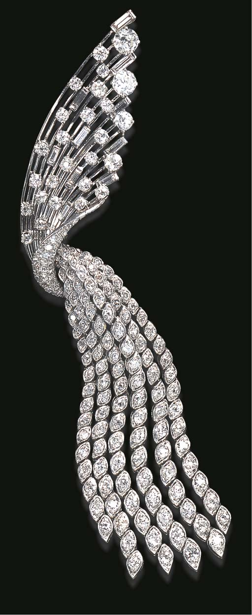 AN ELEGANT DIAMOND BROOCH, BY