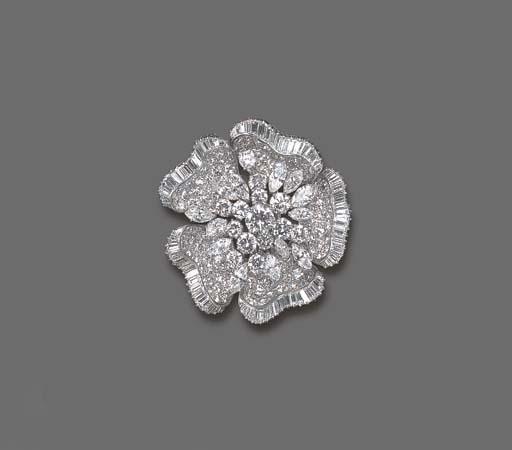 AN ELEGANT DIAMOND FLOWER BROO
