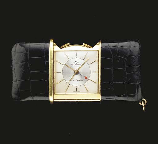Movado. A gilt and leather her