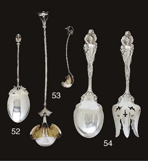 A SILVER SERVING SPOON