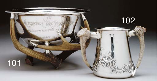 A SILVER LOVING CUP WITH HORN