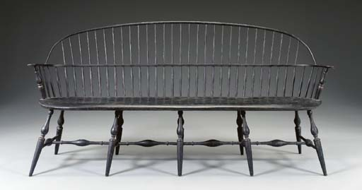 A BLACK-PAINTED BOW-BACK WINDSOR STYLE SETTEE