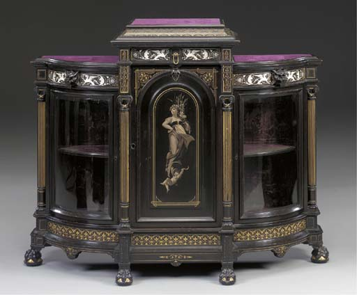 A RENNAISANCE REVIVAL GILDED, CARVED AND INLAID EBONIZED CABINET