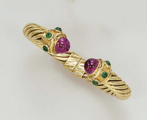 A GOLD AND GEM-SET BANGLE, BY