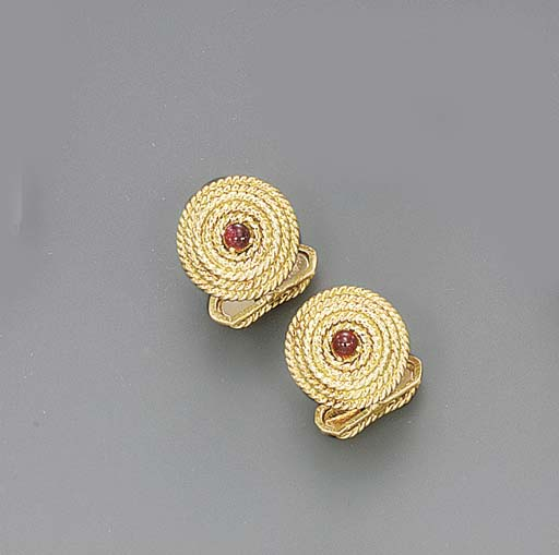 A PAIR OF GOLD AND RUBY CUFF L