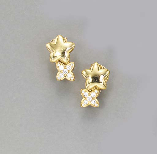 A PAIR OF GOLD AND DIAMOND EAR