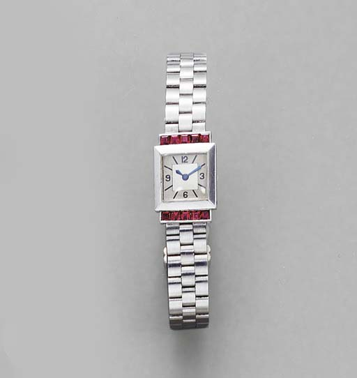 A PLATINUM AND RUBY WRISTWATCH
