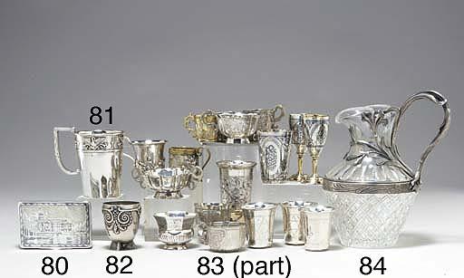 A SILVER-MOUNTED GLASS JUG
