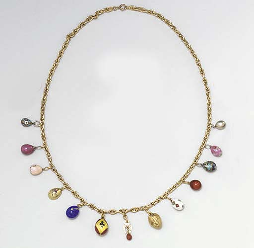 A NECKLACE OF THIRTEEN JEWELLE