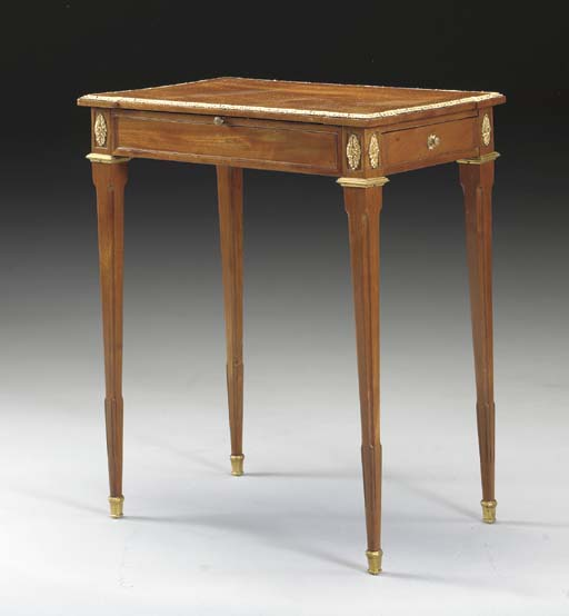 A LOUIS XVI ORMOLU-MOUNTED MAHOGANY TABLE A ECRIRE