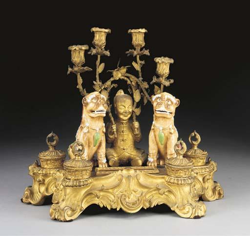 A Louis XV style porcelain-mou