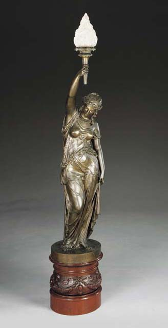 A bronze-patinated figural tor
