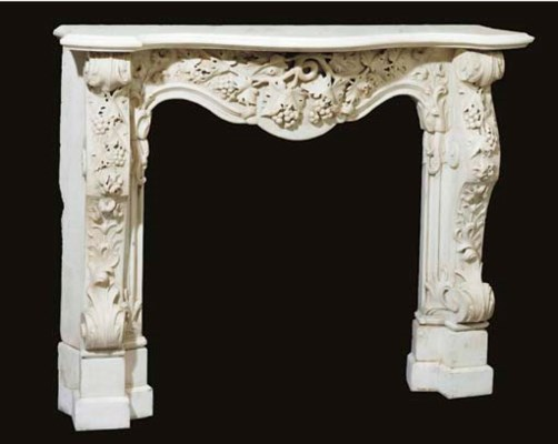 A Rococo style carved white ma
