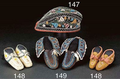 A PAIR OF IROQUOIS BEADED HIDE