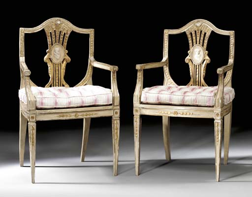 A PAIR OF NORTH ITALIAN NEOCLASSIC WHITE-PAINTED, PARCEL-GILT AND SILVERED ARMCHAIRS