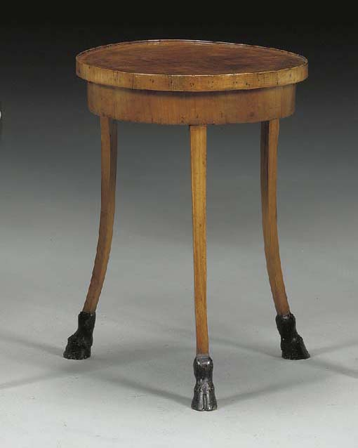 AN ITALIAN NEOCLASSIC STYLE FRUITWOOD AND EBONIZED CENTER TABLE