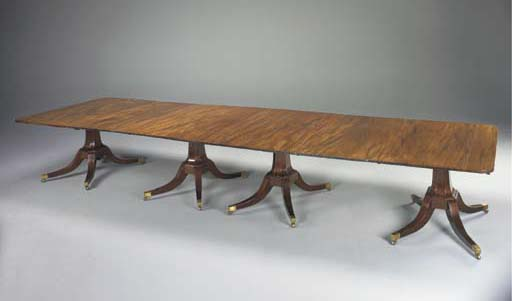 A REGENCY MAHOGANY AND HARDWOOD FOUR-PEDESTAL DINING-TABLE