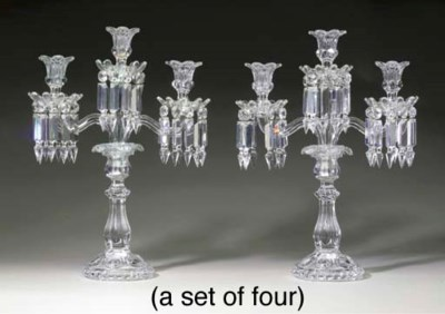 A SET OF FOUR FRENCH MOLDED GL